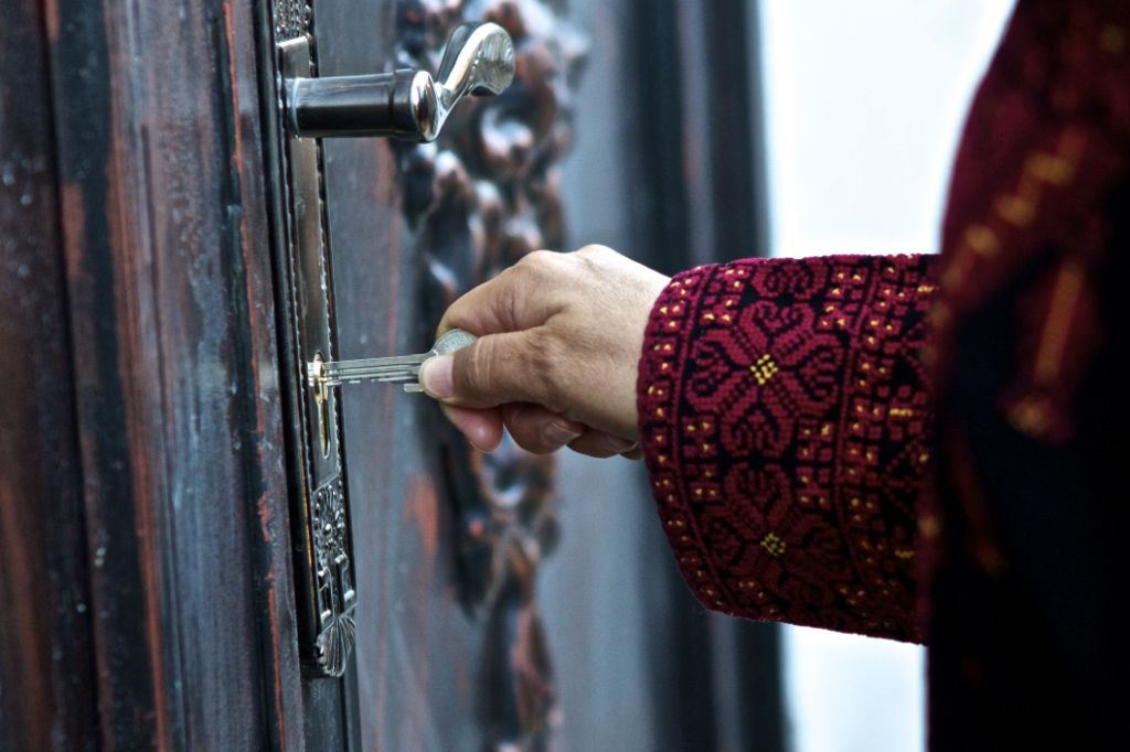 Aribiya-unlocking-the-door