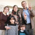 Nisreen and Hashem Azzeh with their family