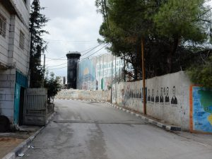 Portraits of martyrs on the wall of Aida camp.