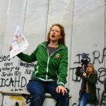 Ruth with Travel2Palestine group by wall