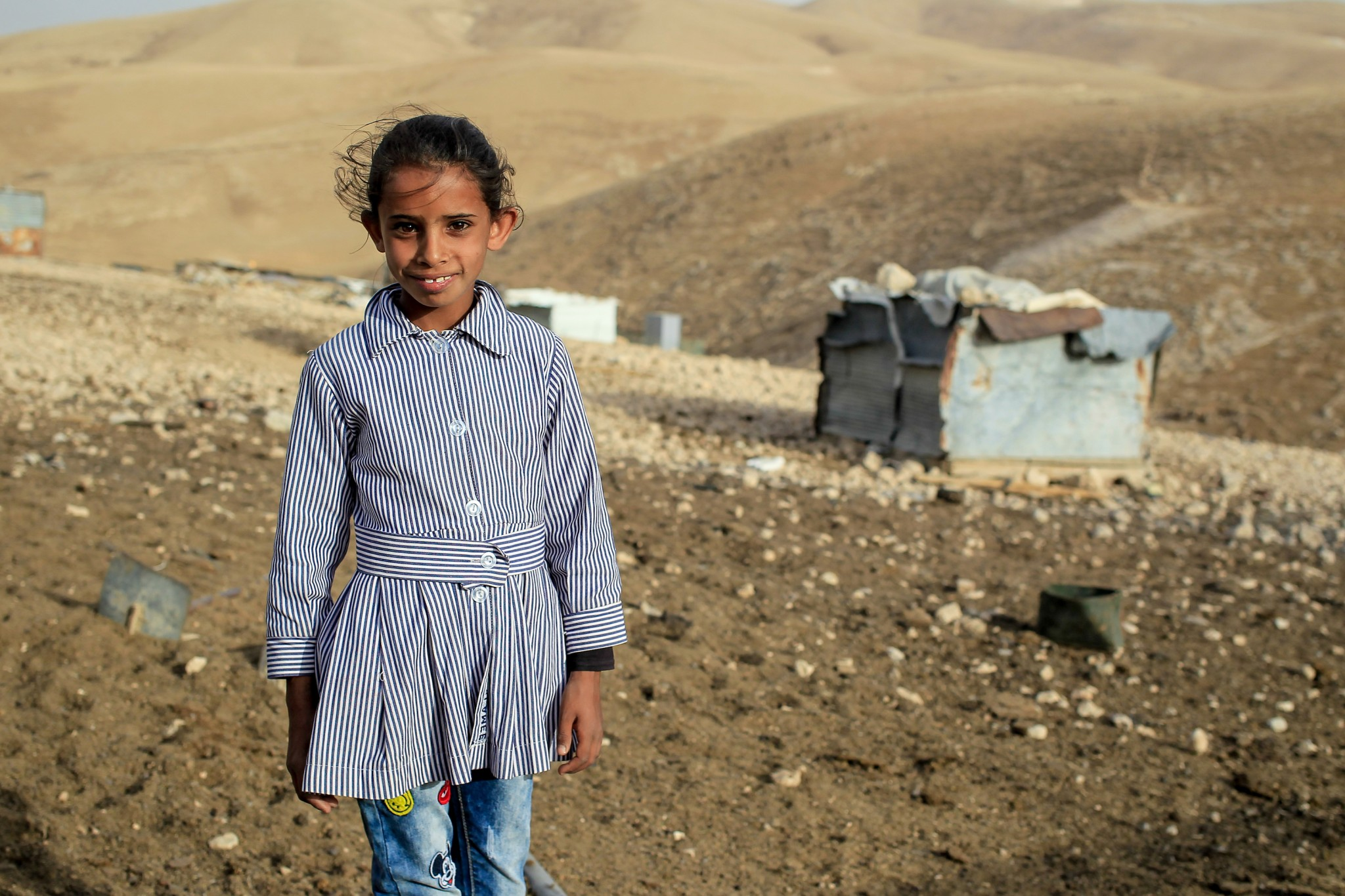Girl standing near site of Al Muntar school - photo by Lys Arango